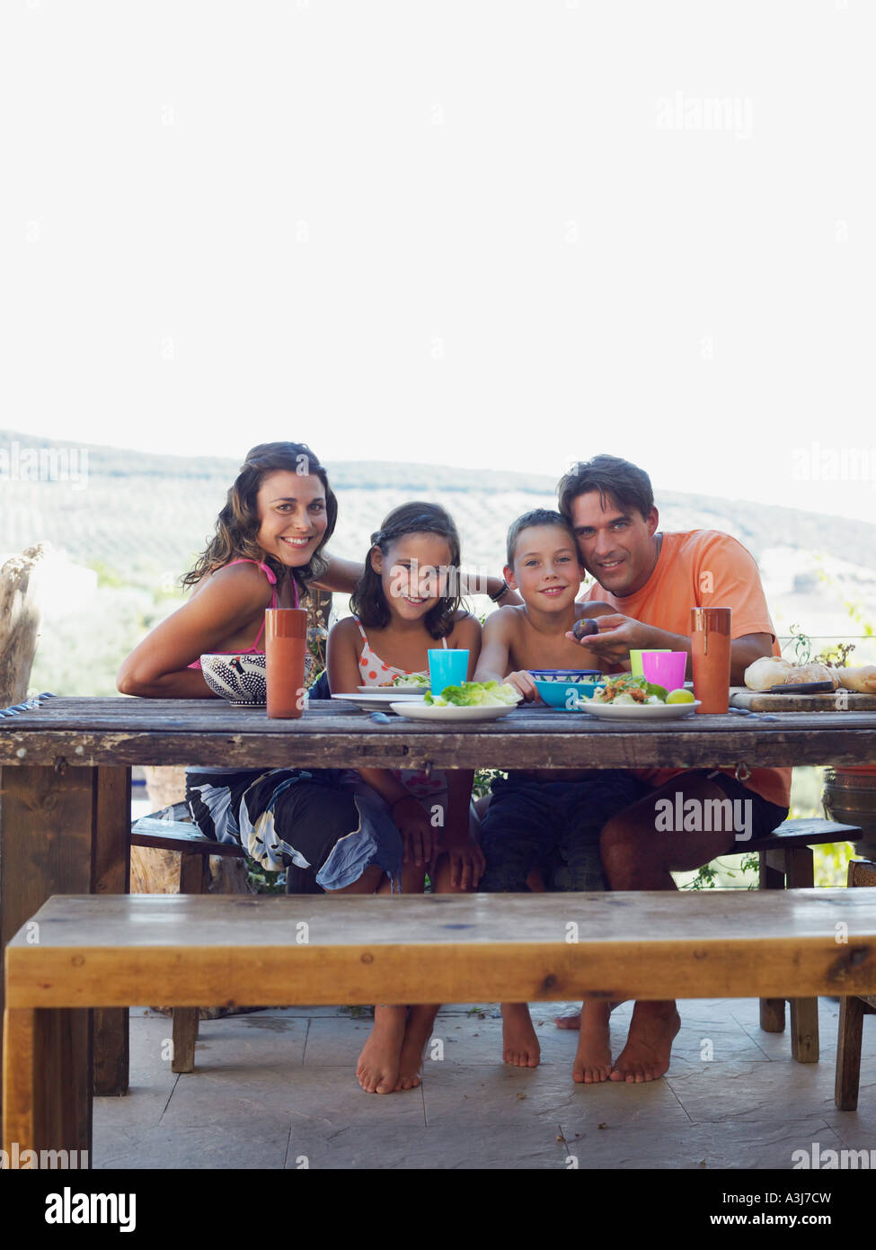 Family having meal outdoors - Stock Image