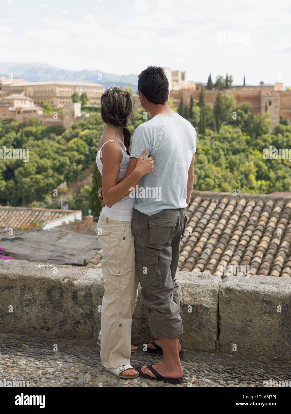 Couple looking towards alhambra - Stock Image