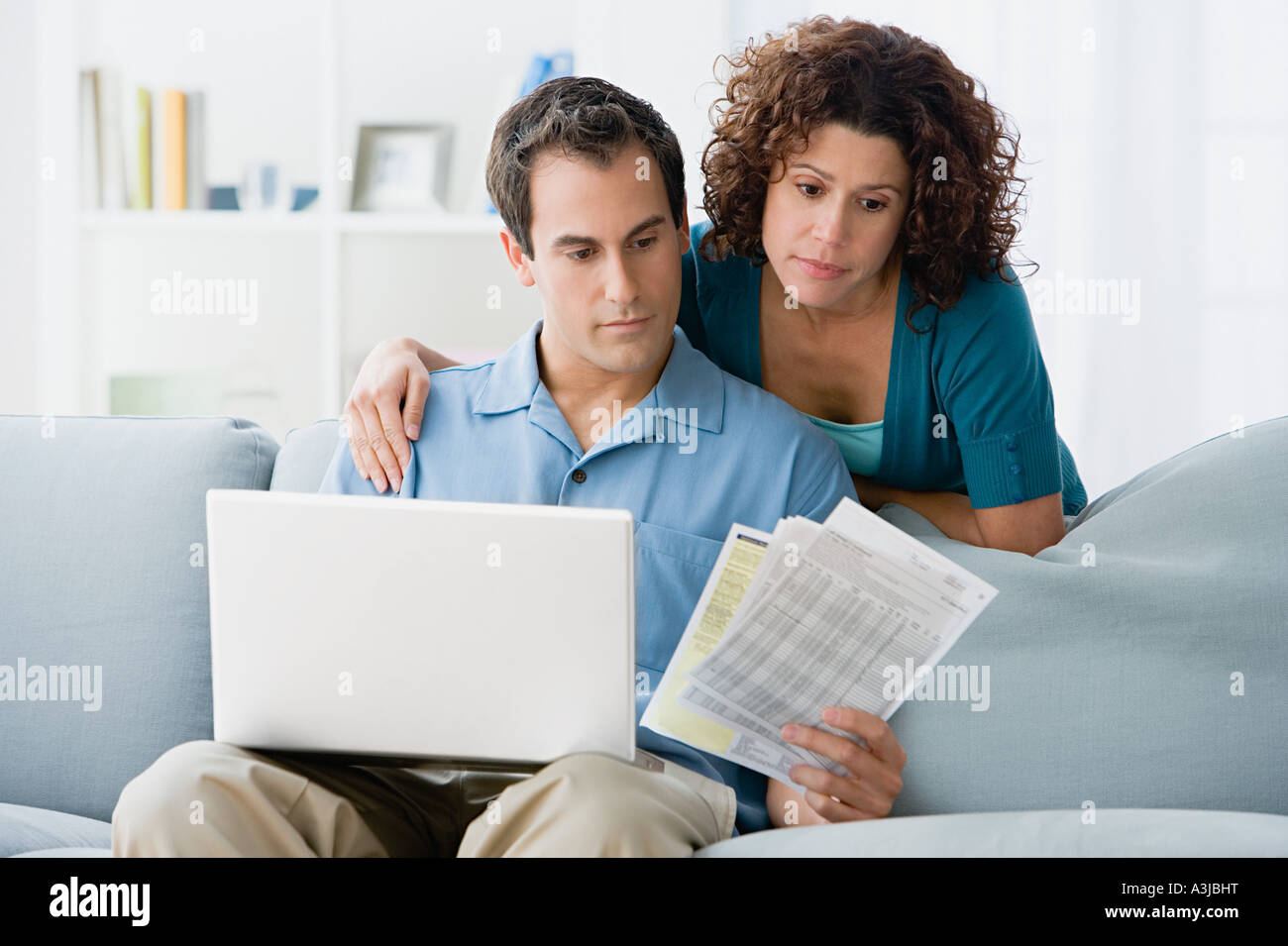 Couple looking at home finances on computer Stock Photo