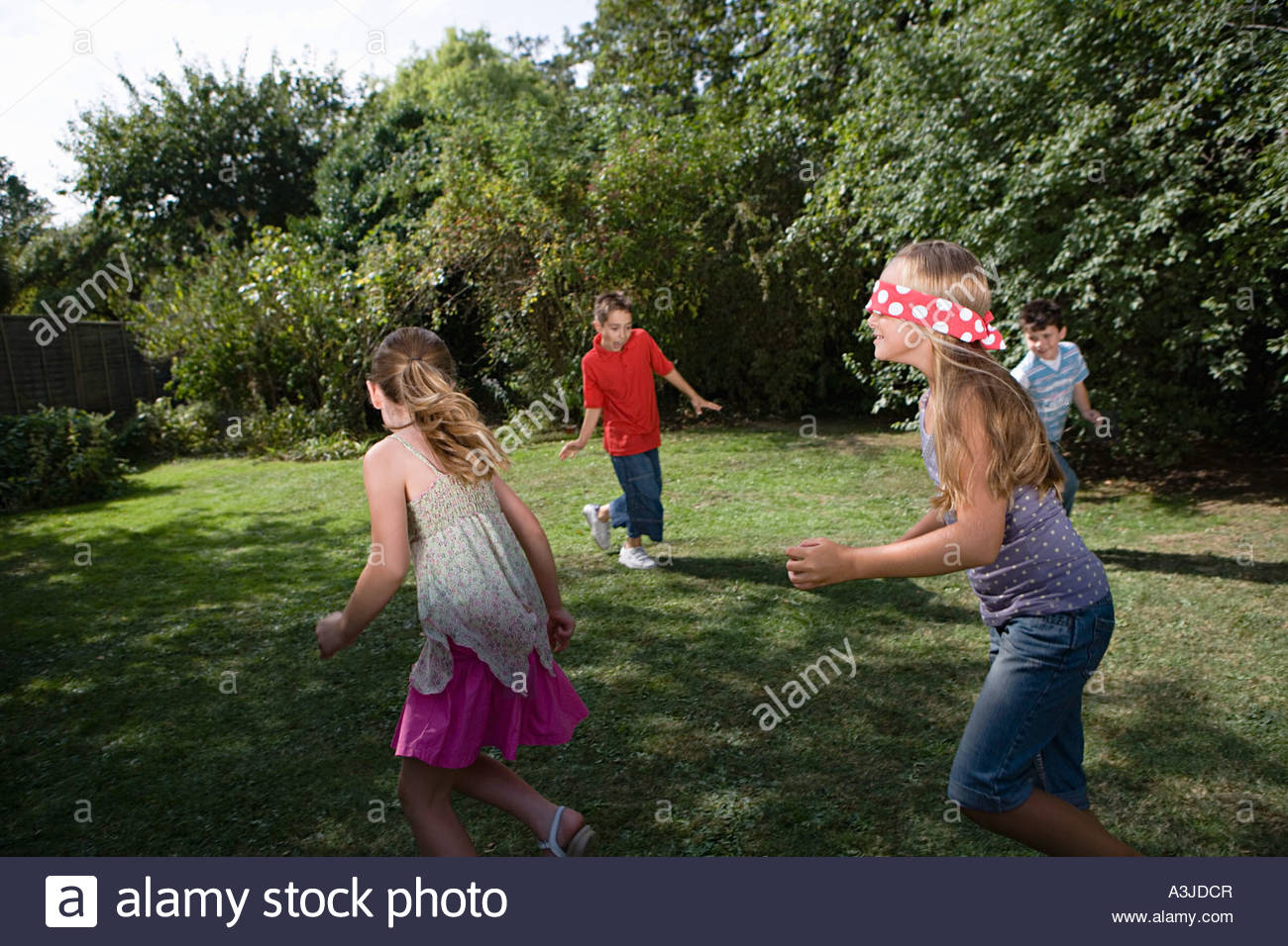 Children playing blind mans bluff - Stock Image