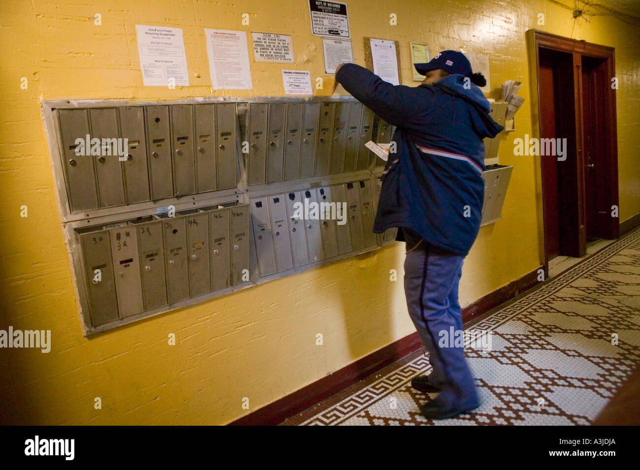 A United States Postal Service delivers mail to an apartment ...