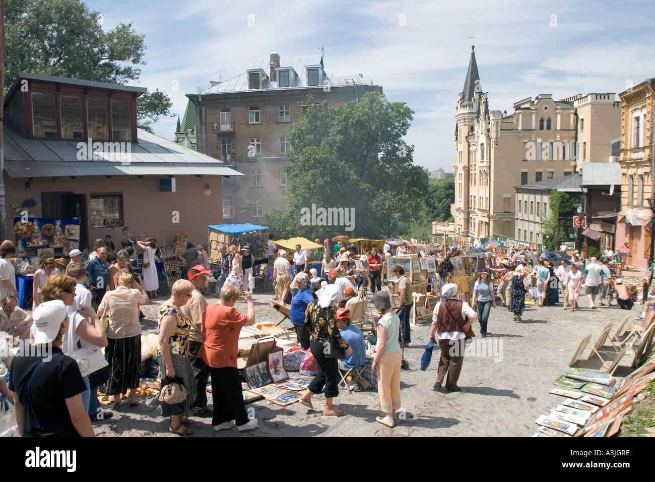 Andrijivskyj road souvenir market and dealer shoppers with view to castle Lion Heart in Kiev, Ukraine 2005 - Stock Image
