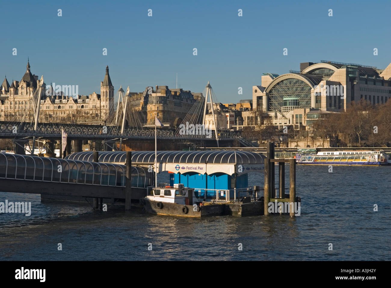 New Hungerford Foot Bridge and Charing Cross Station London UK - Stock Image