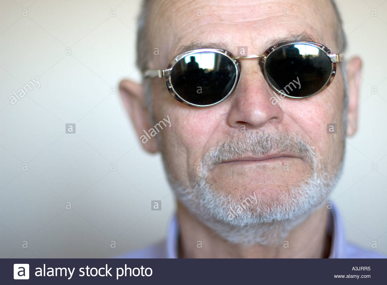 Portrait Of An Elderly Grey Haired Man Wearing Retro Sun Glasses