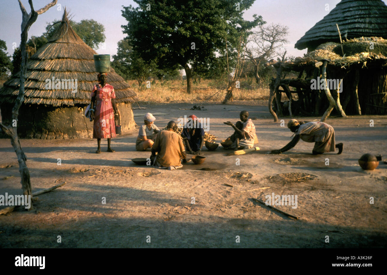 Tribeswomen in traditional rural village of Southern Sudan, Africa 2004 - Stock Image