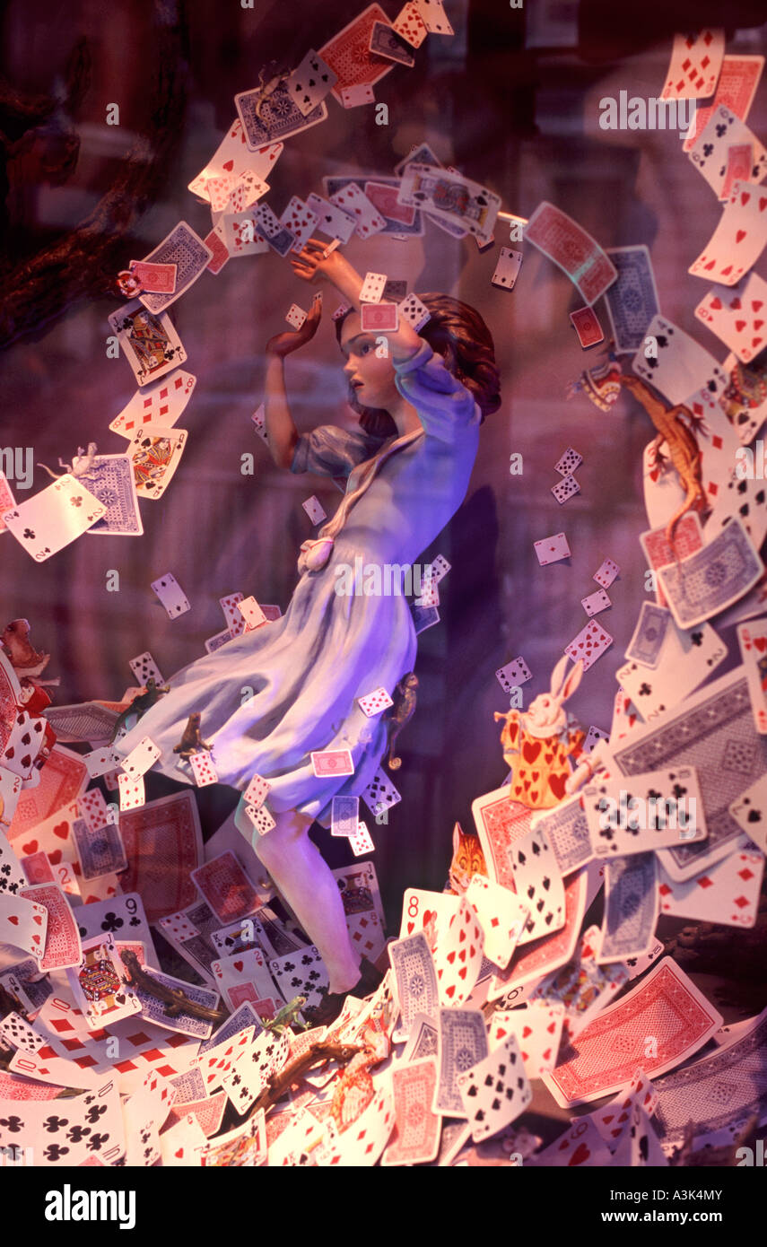 Alice in Wonderland in whirlwind of playing cards in Christmas window display of Fortnum and Mason department store, - Stock Image