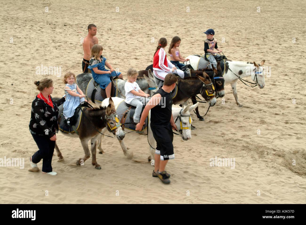 Donkey Rides on the beach at Weston Super Mare England UK Stock Photo
