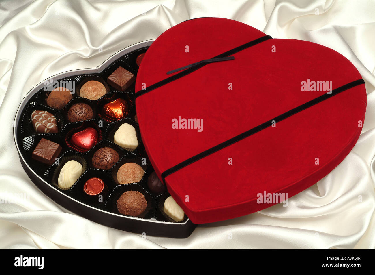 Heart-shaped box of chocolates - Stock Image