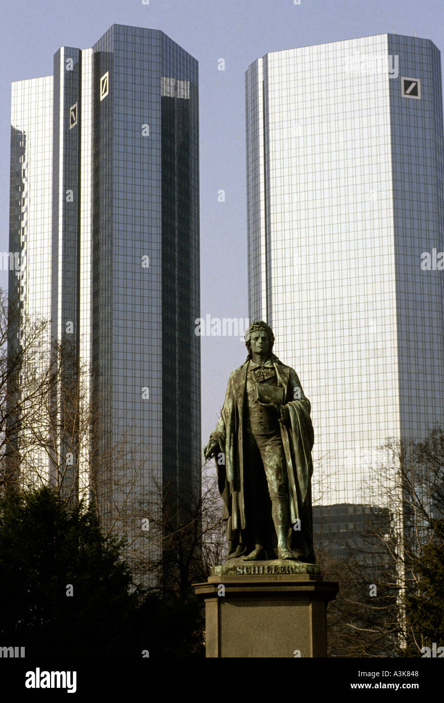 Statue of Schiller against the headquarters of the Deutsche Bank and corporate offices in Frankfurt, Germany - Stock Image