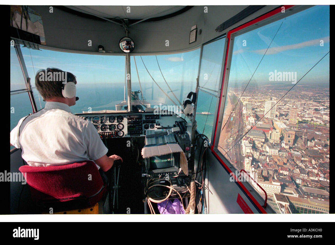 Police airship on surveilance duty over the south coast of England Stock Photo