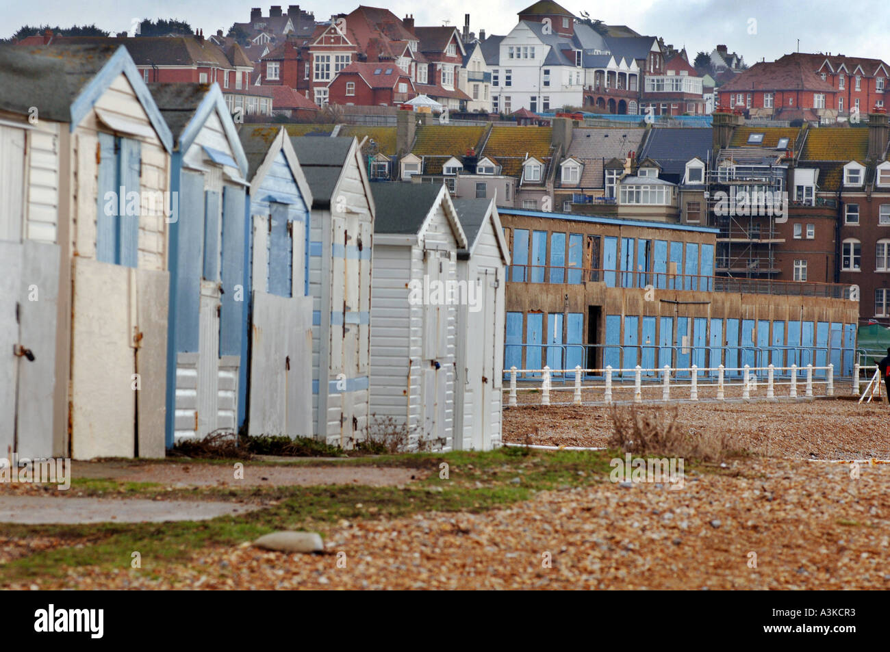Traditional Edwardian wooden beach huts next to concrete 1930s beach chalets at St Leonards on Sea,  East Sussex - Stock Image