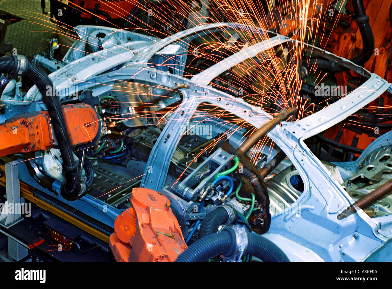 Industry robot robotics spot welding car production at BMW in Munich Bavaria Germany Stock Photo