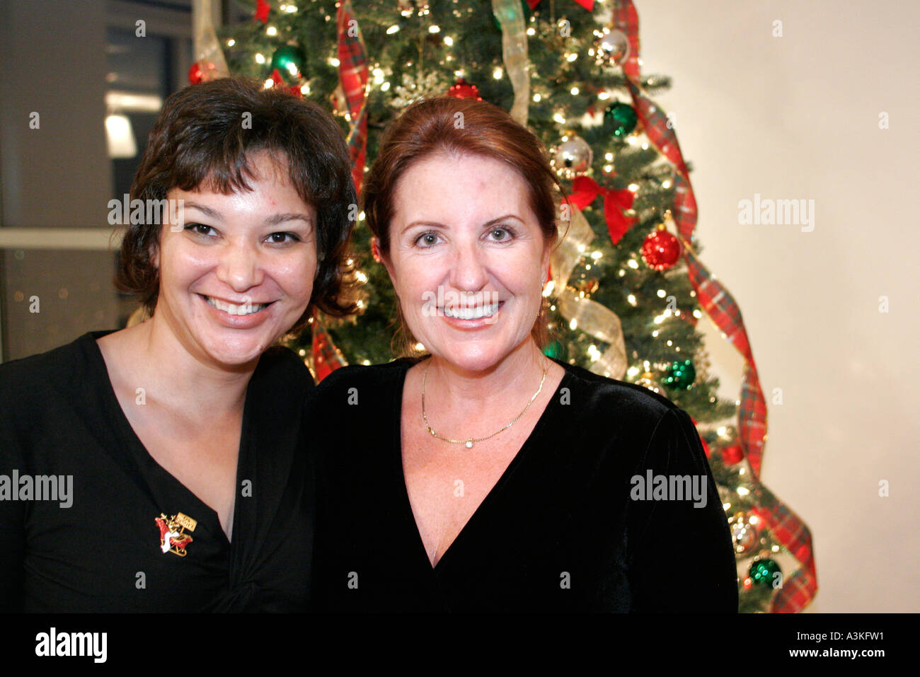 Miami Florida office Christmas party coworkers women tree ...