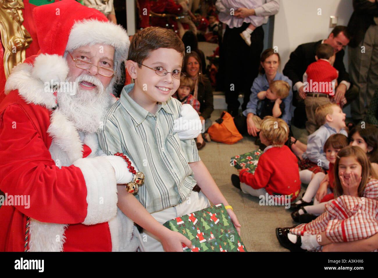 Miami Florida office Christmas party Santa Claus children presents ...