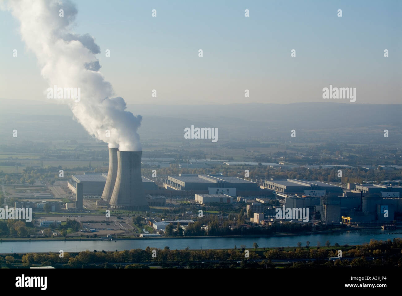 Smoke emitting from cooling towers Tricastin nuclear power plant in the Rhone river valley, Drome, France - Stock Image