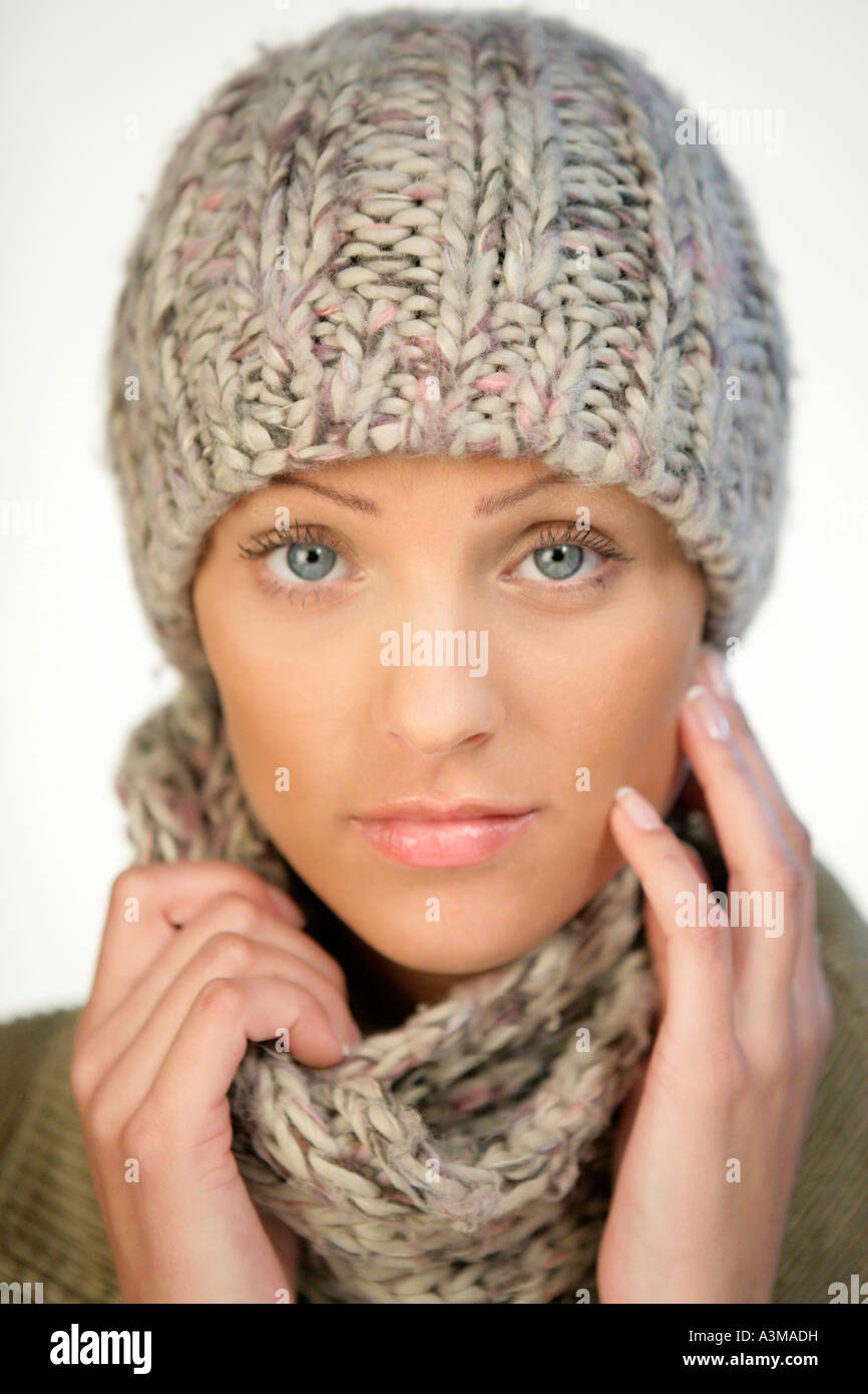 fc8ef0eaabaa Young woman wearing woolen cap and scarf Stock Photo  10816444 - Alamy