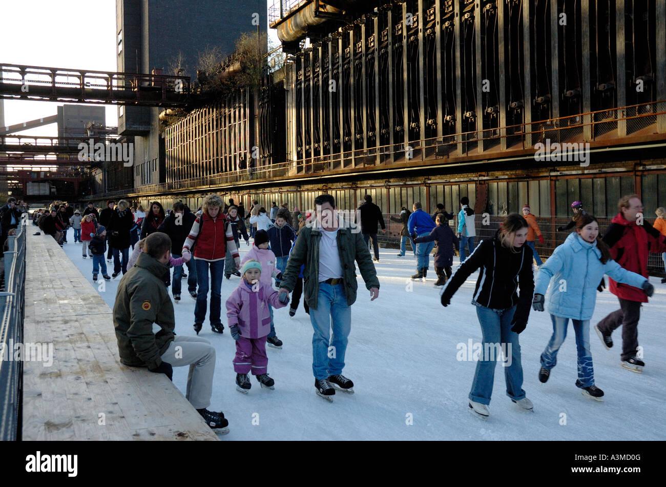 Ice skating at the UNESCO world heritage site Zollverein, Essen, Germany. - Stock Image
