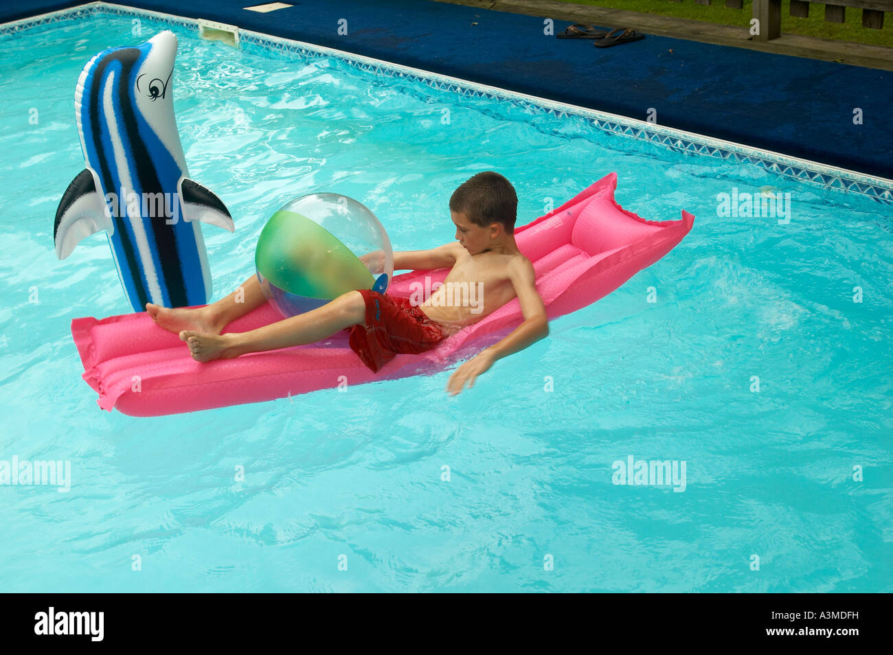 1 One Young 8 9 Eight Nine Year Old Boy Enjoys Swimming Pool Inflatable  Dolphin Toy