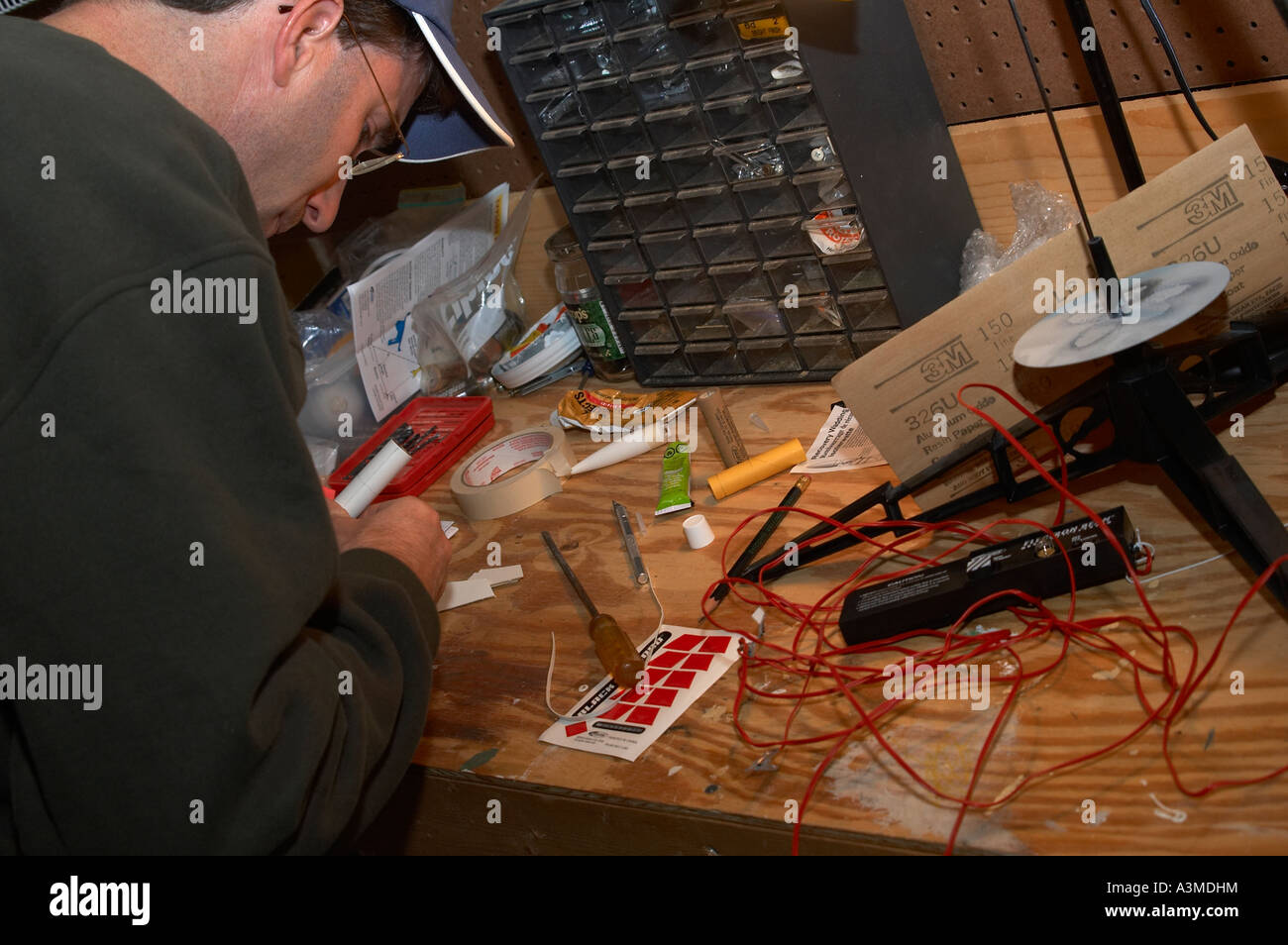 Basement Workshop Stock Photos Images Alamy Wiringhomevisioedit71111jpg Father Man Male Assembles Toy Rocket Image