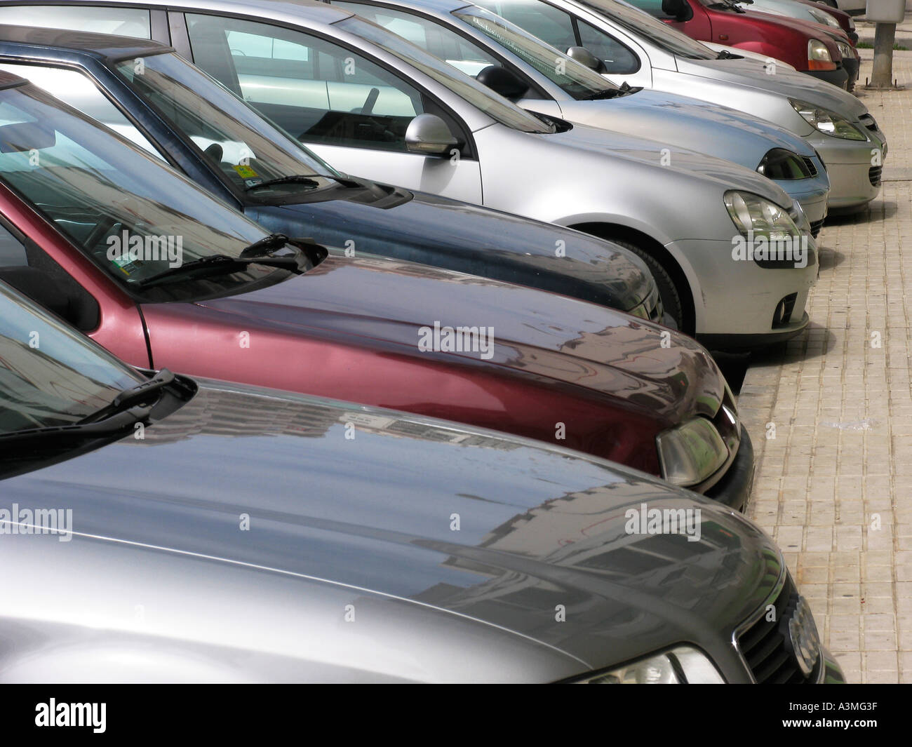 Line of parked cars in city street - Stock Image