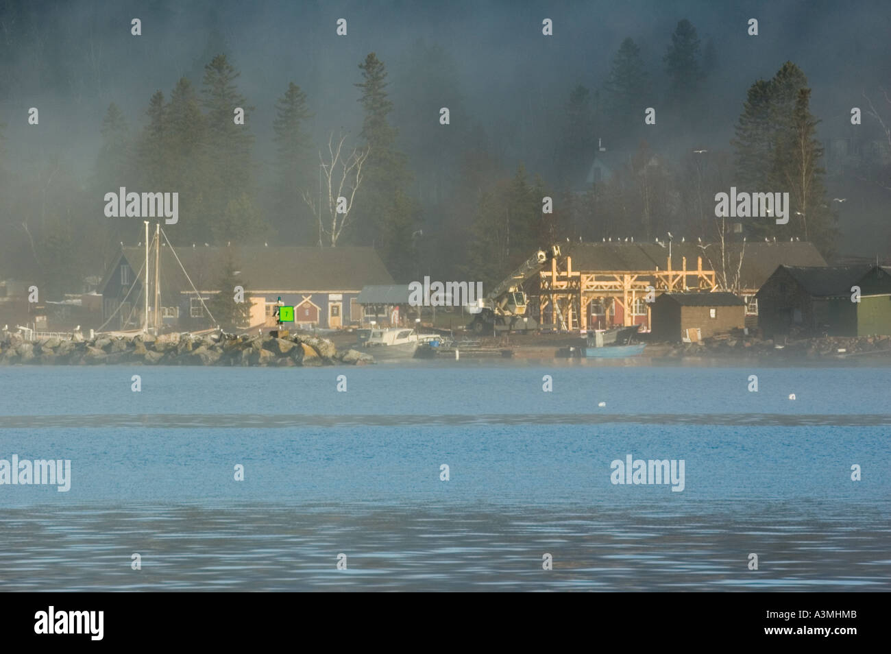 Grand Marais, MN harbor and the Northhouse Folk School. - Stock Image