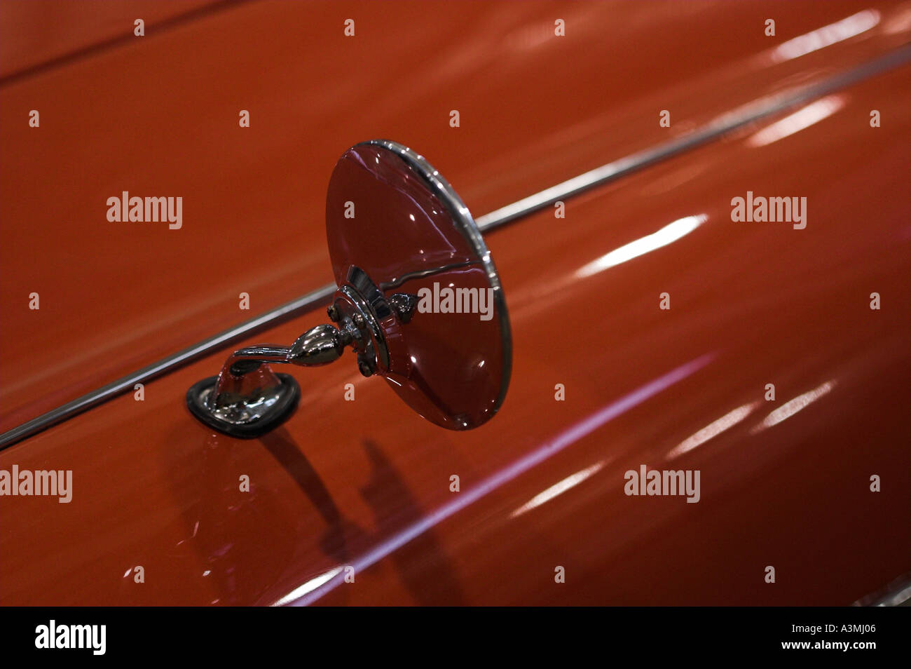 old collectible car show shinny british classic sport red orange mirror - Stock Image