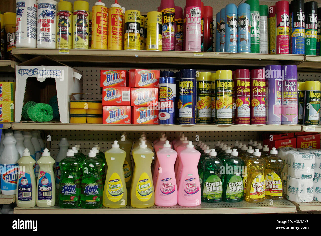 Florida FL South Miami Overtown L & J Groceries shelf shelves shelving products display sale product cleaning products soap pesticides bug Stock Photo
