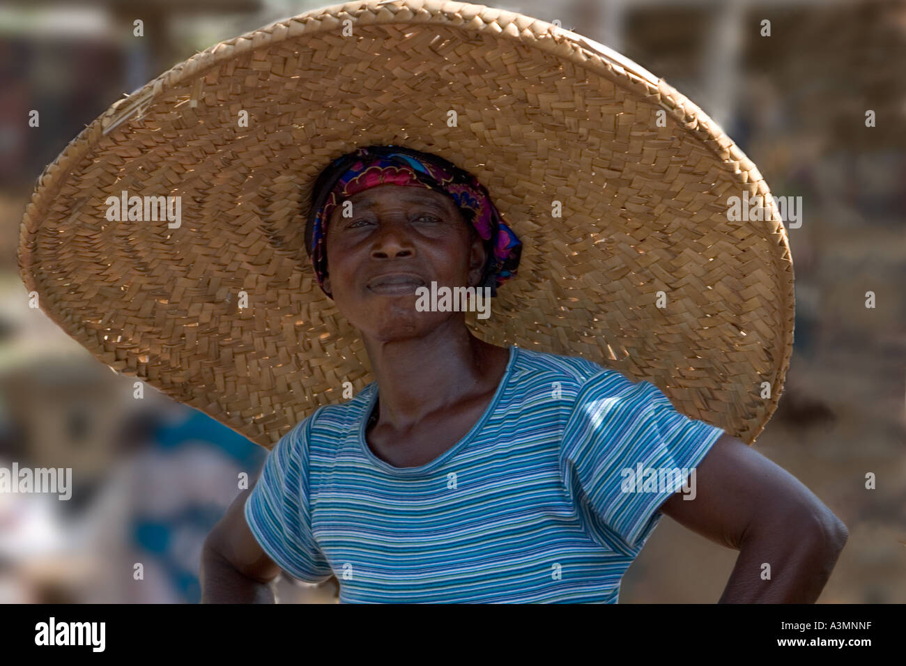 Portrait of woman market trader wearing large straw hat  Ghana, West Africa - Stock Image