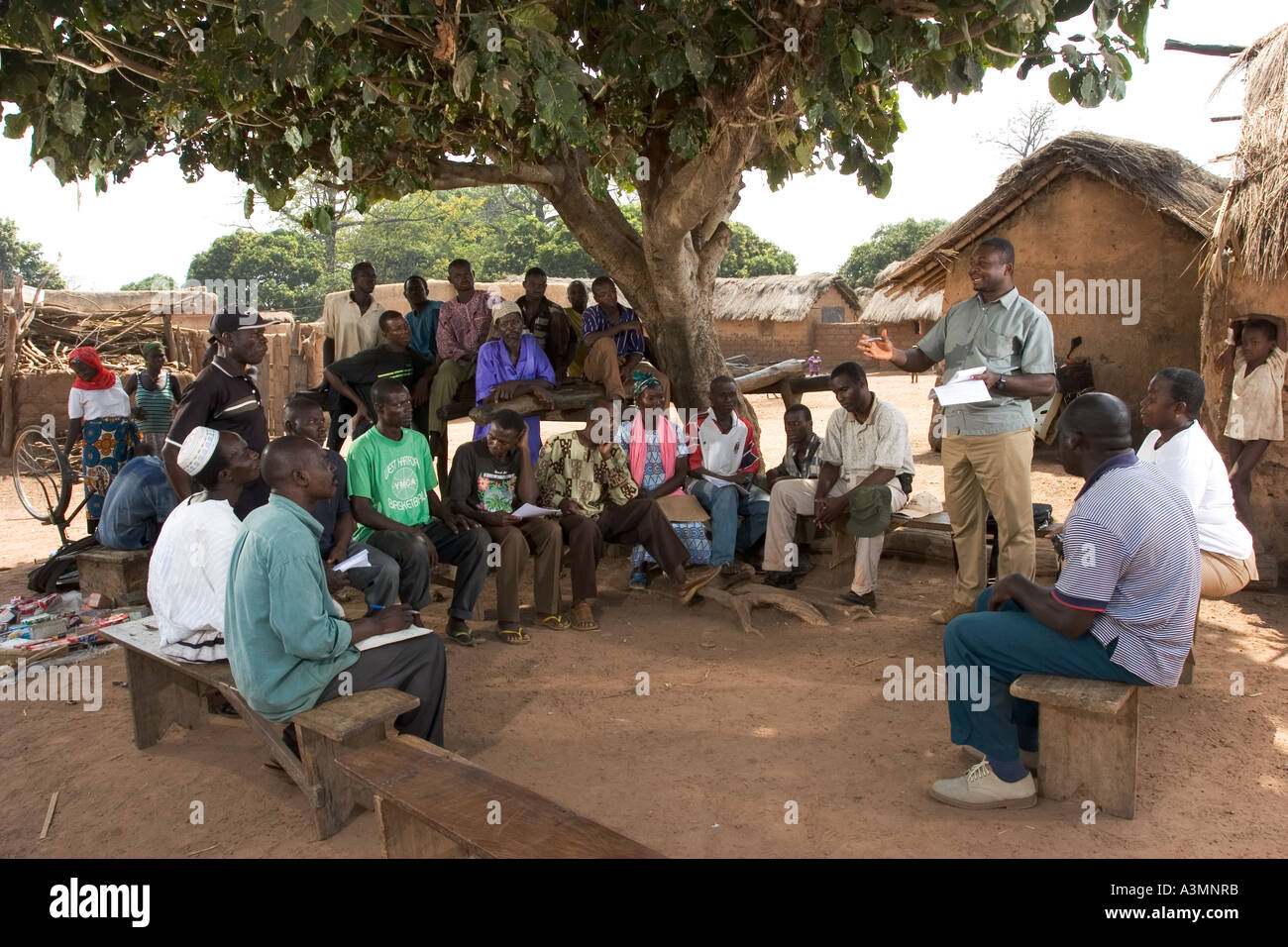 Villagers in Northern Ghana meeting to discuss conservation and environmental concerns within the village community. - Stock Image