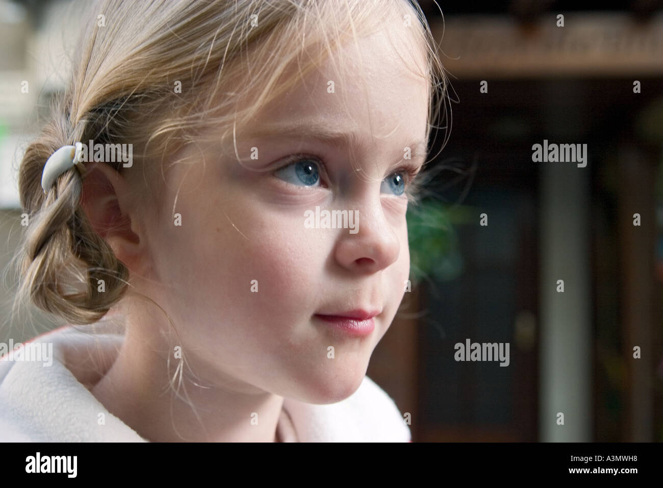 Profile portrait of a young girl looking straight Stock Photo