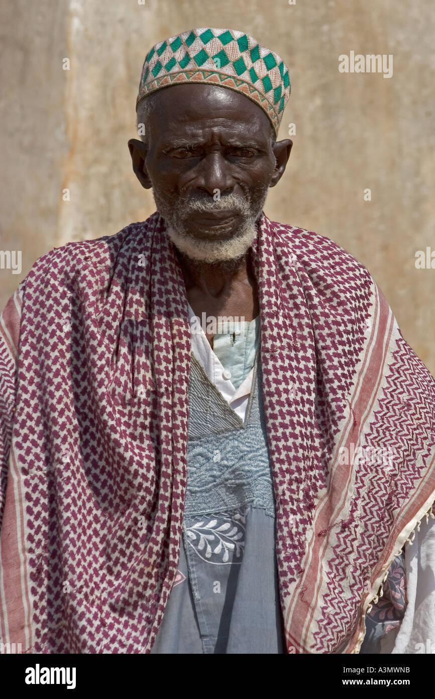Elderly Imam outside Larabanga Mosque Ghana West Africa - Stock Image