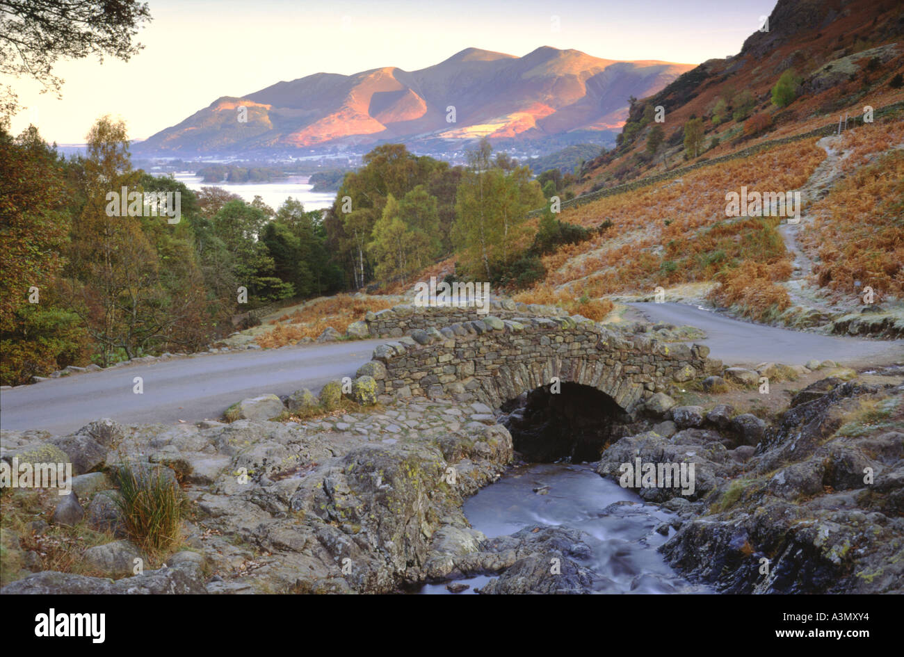 Ashness Bridge looking across to Derwent Water and Skiddaw, within the Lake District - Stock Image