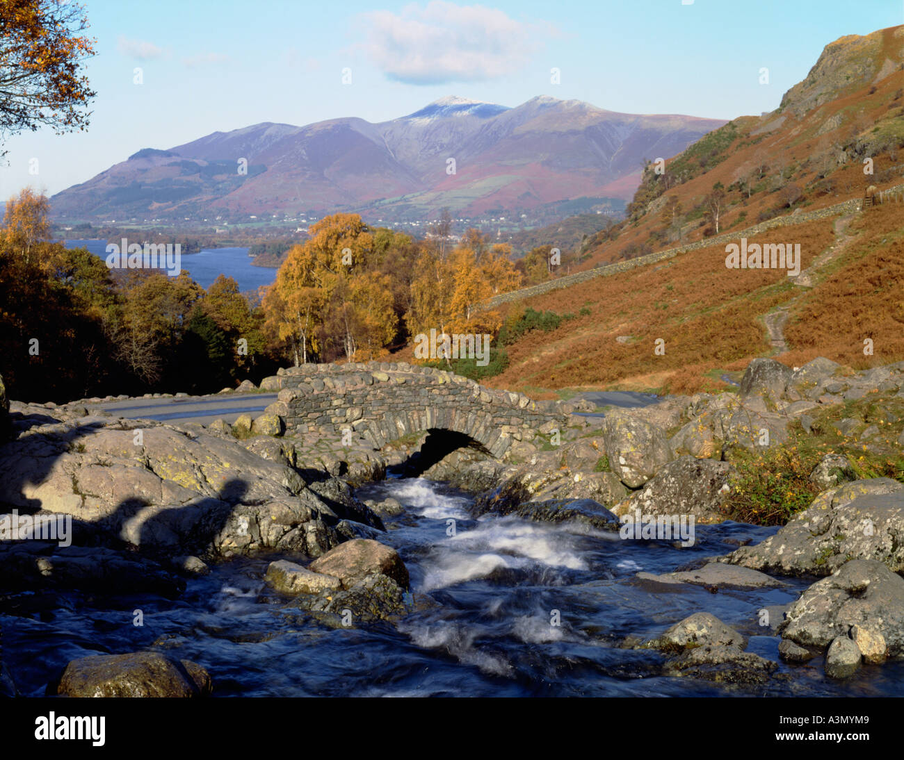 Ashness Bridge looking across to Derwent Water and Skiddaw, within the Lake District, Cumbria - Stock Image
