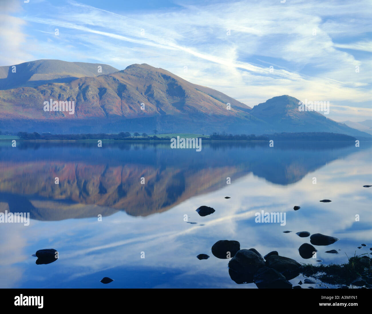 Calm view of the still waters of Bassenthwaite Lake with Skiddaw and Ullock Pike Lake District National Park, Cumbria, England. - Stock Image