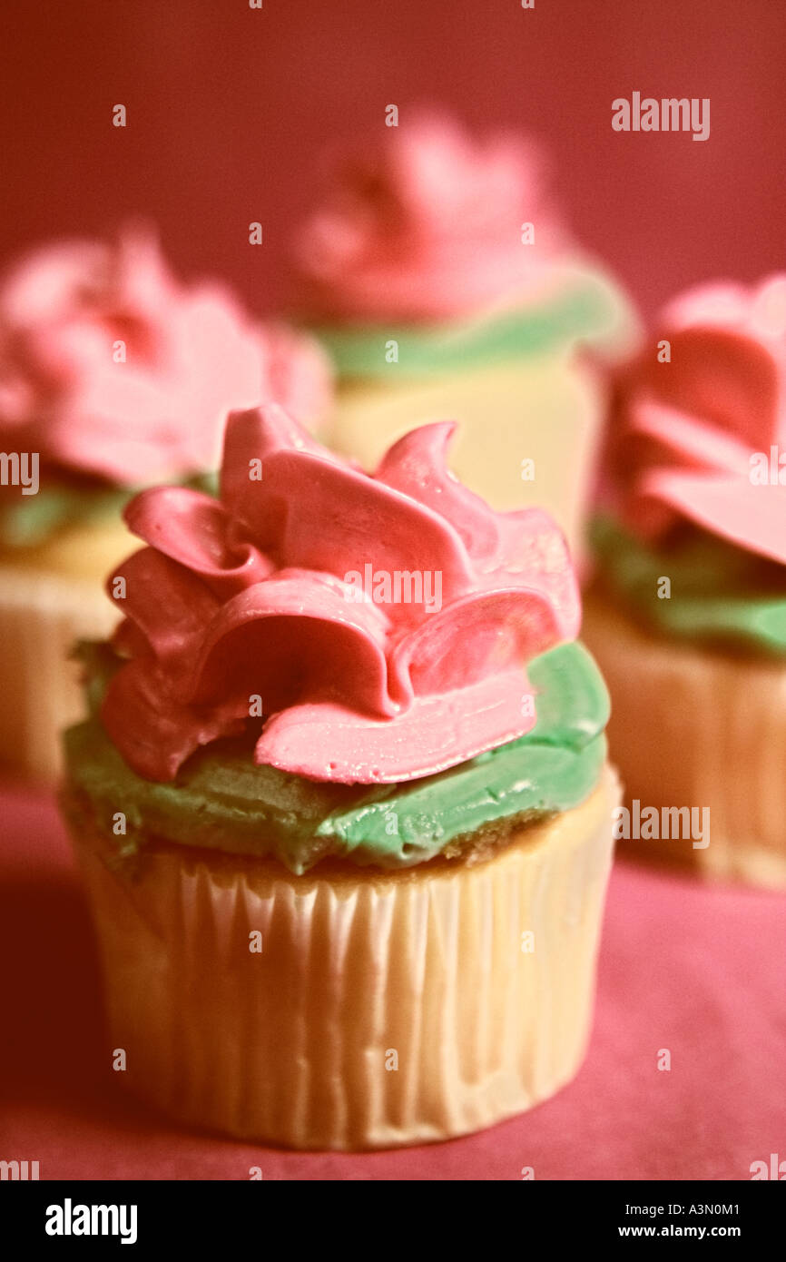 Four Pink Flower Cupcakes Vertical Stock Photo 6184256 Alamy