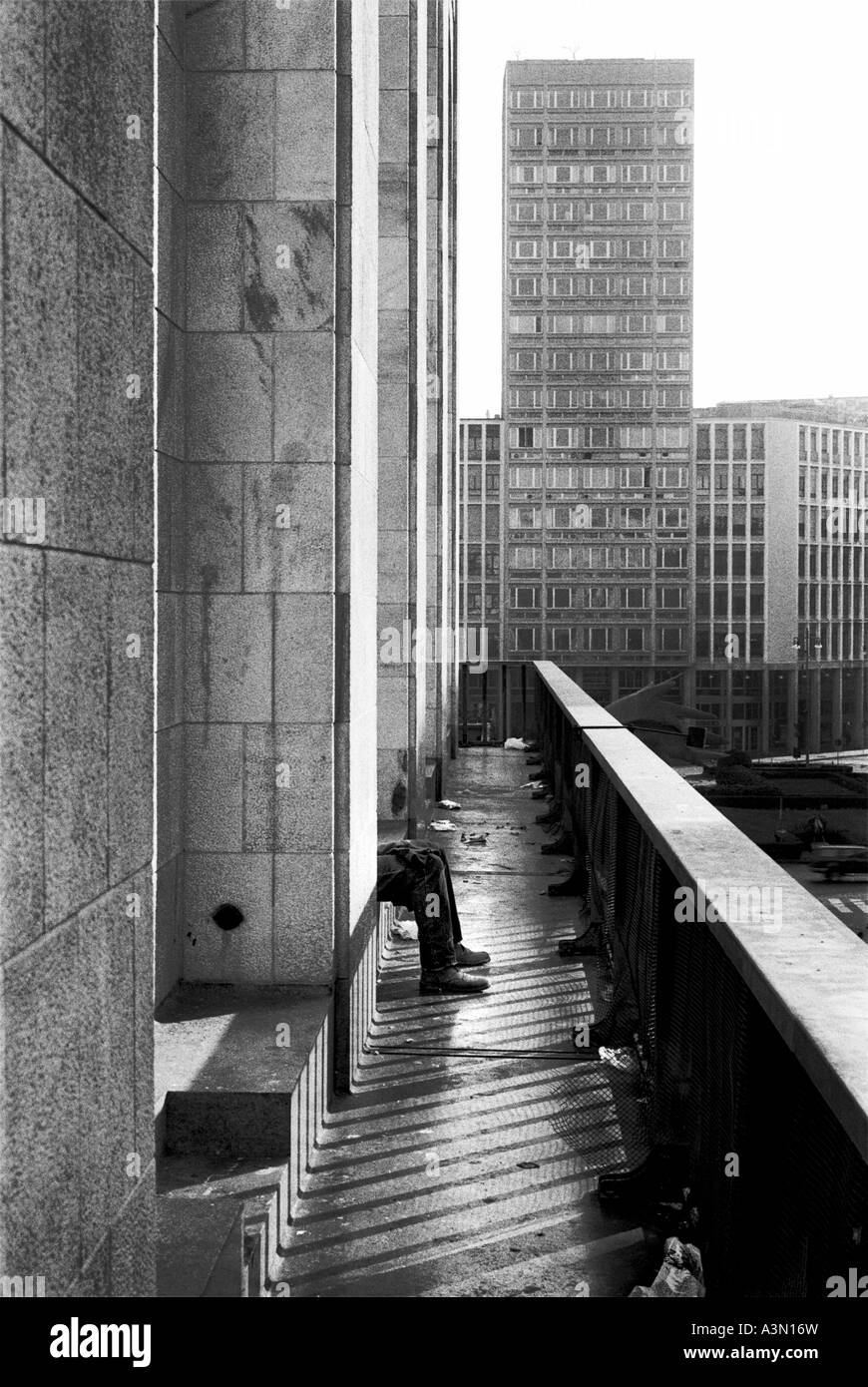 Milan, Italy. A man seated between skyscrapers - Stock Image