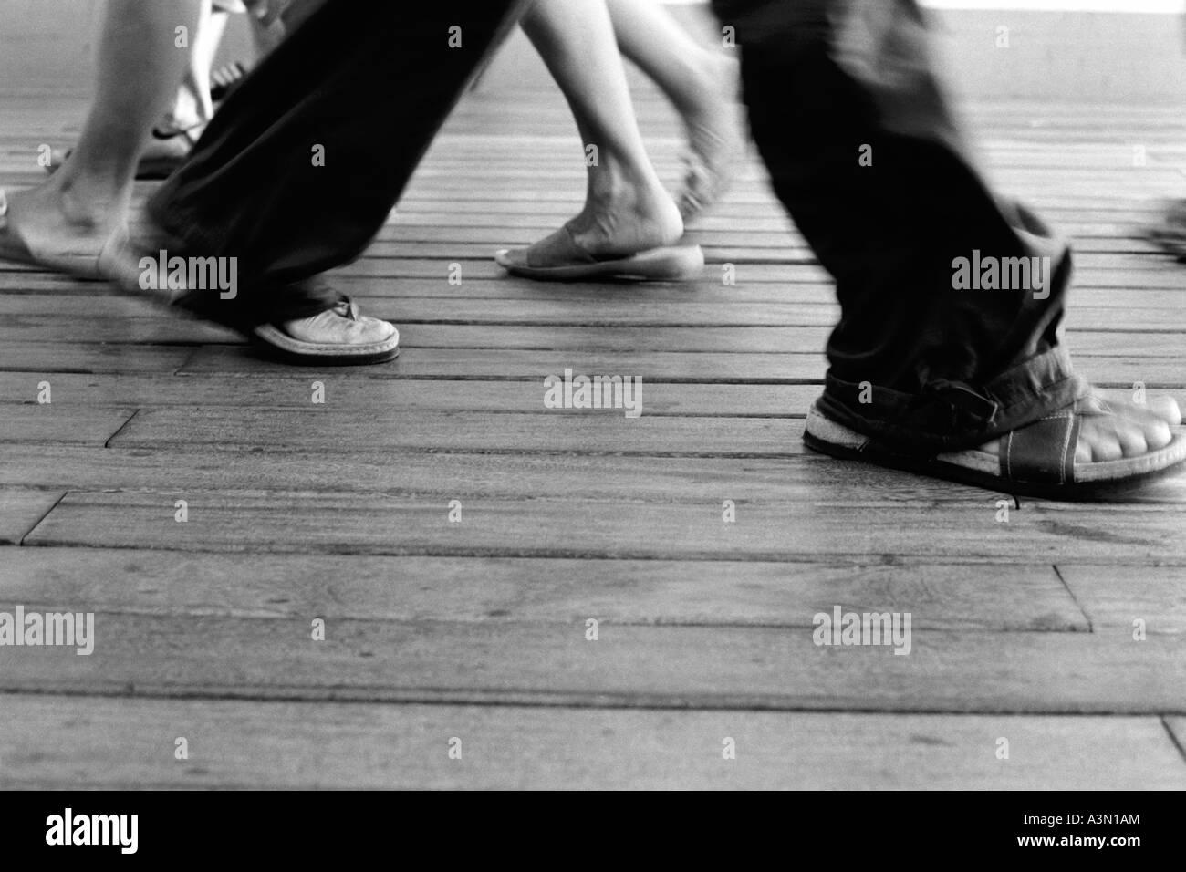 Feet of walking people - Stock Image