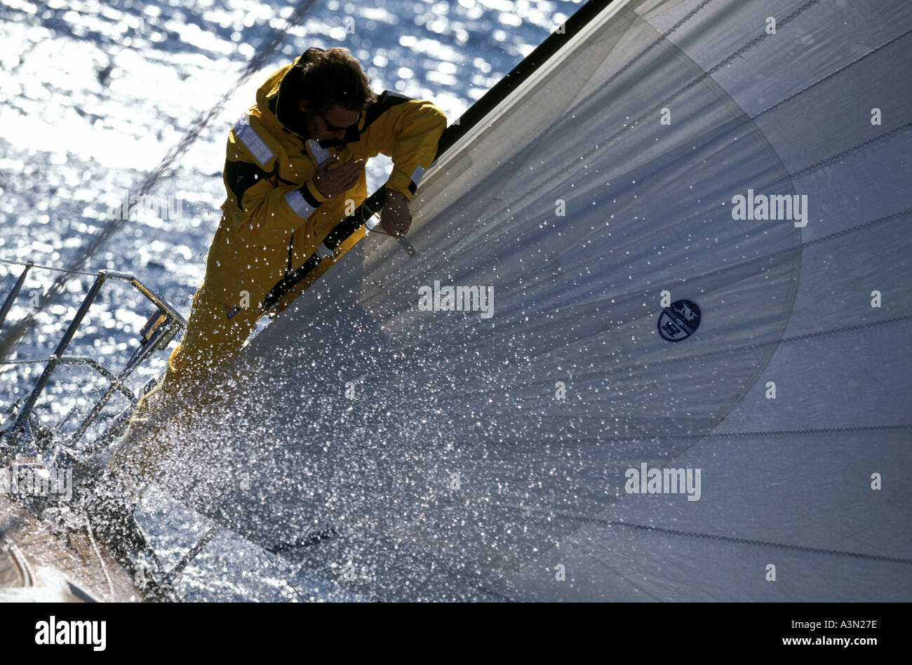 Musto clad bowman on Swan 56 - Stock Image