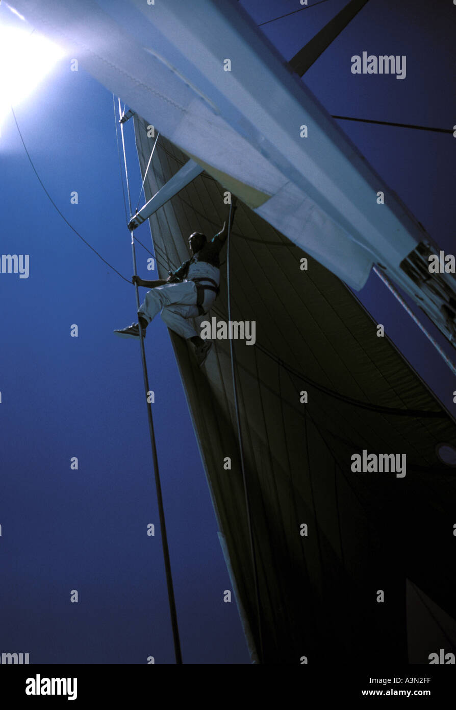 Sailor up the mast - Stock Image
