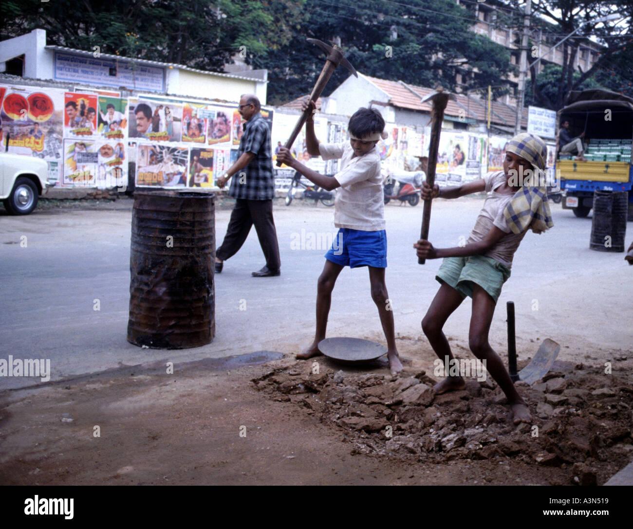 Children work on road construction. Mysore. India. - Stock Image