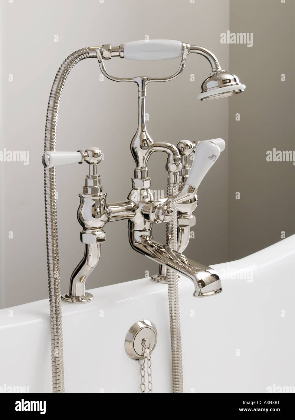 Luxury classic design tap bathroom faucet chrome silver standing on edge of bath - Stock Image
