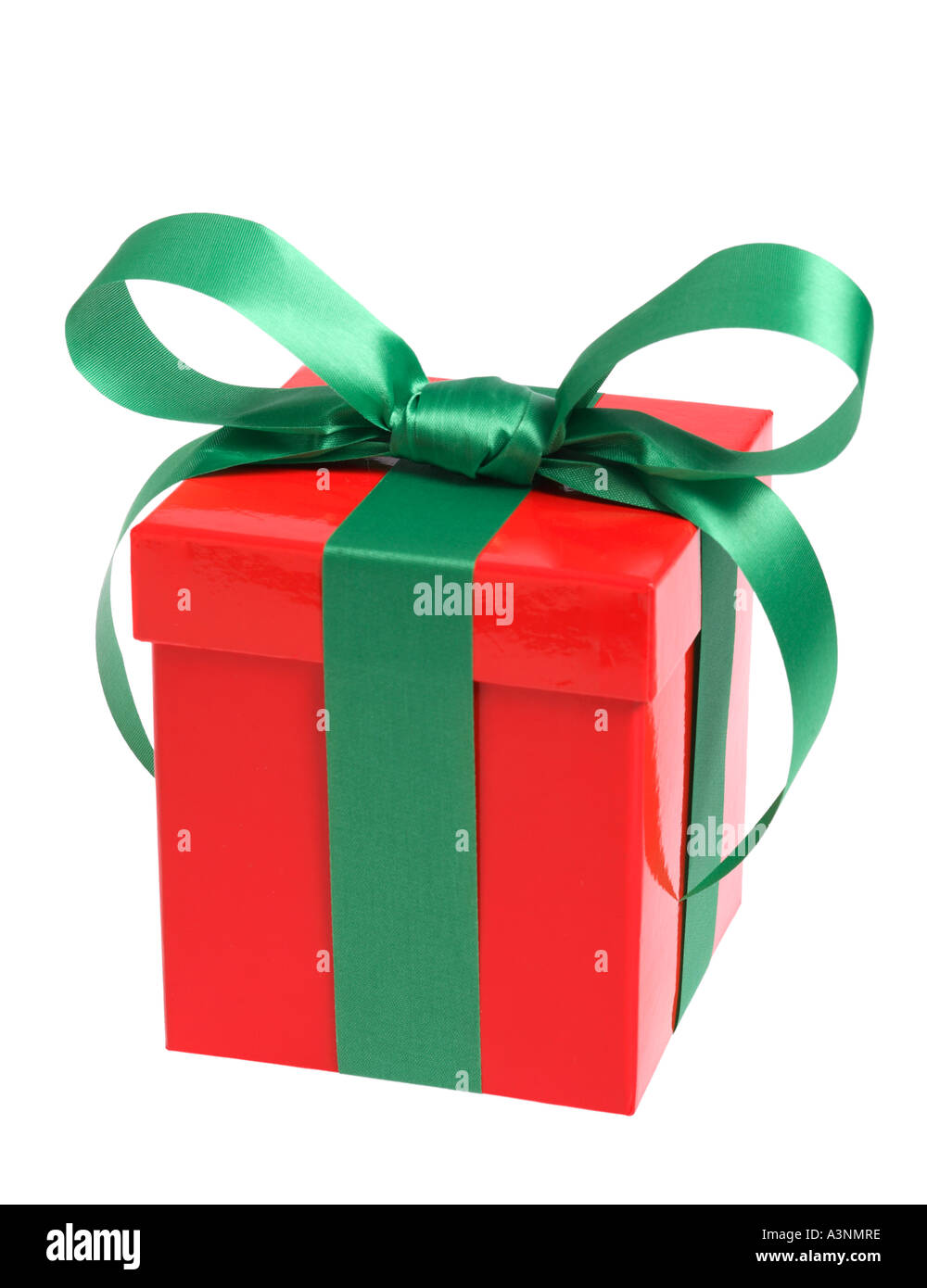 Single Red Christmas Present with Green Bow - Stock Image