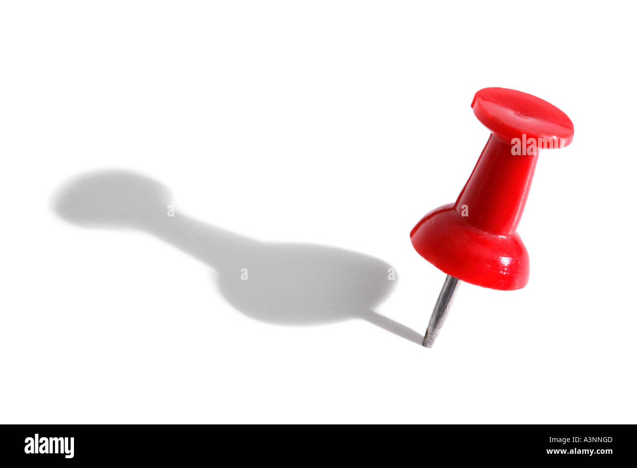 Red push pin with shadow - Stock Image