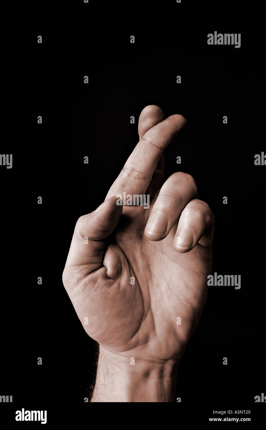 Hand with fingers crossed luck lucky gesture - Stock Image