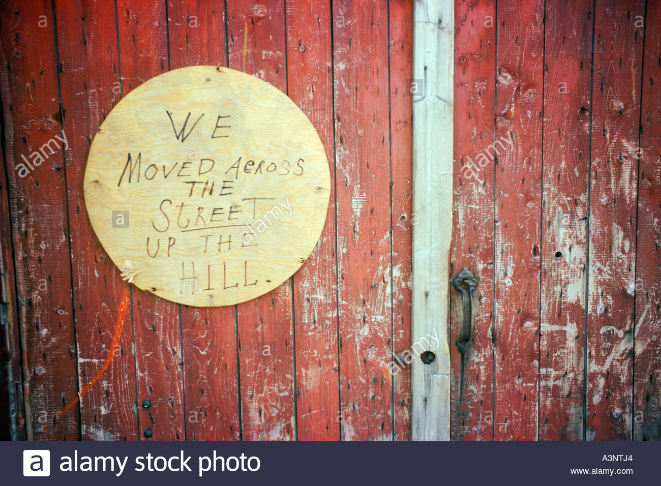 Sign says 'we moved across the street up the hill' on door of mill at Moncton New Brunswick Canada - Stock Image
