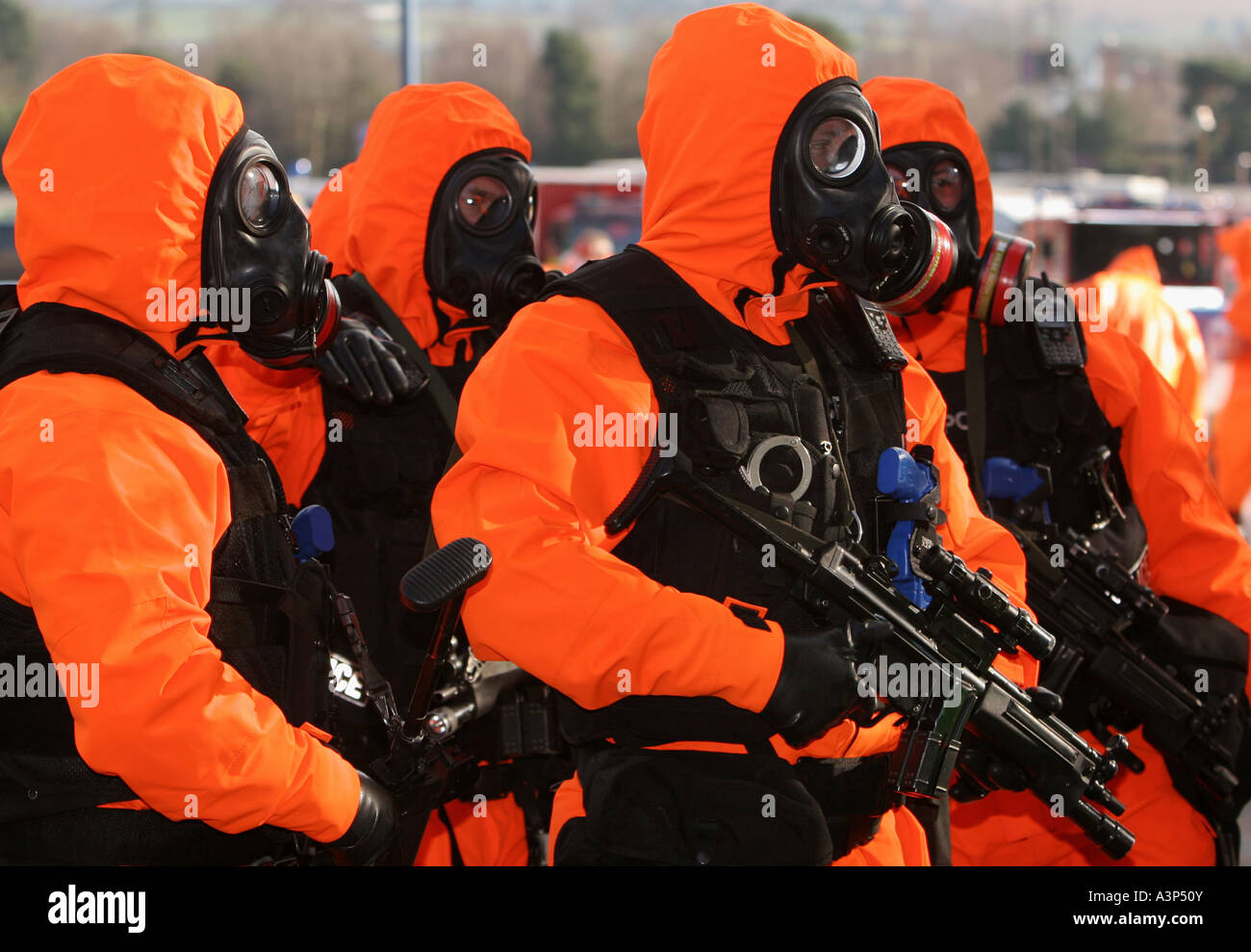 British armed police dressed in anti nuclear chemical warfare suits training for terror attacks - Stock Image