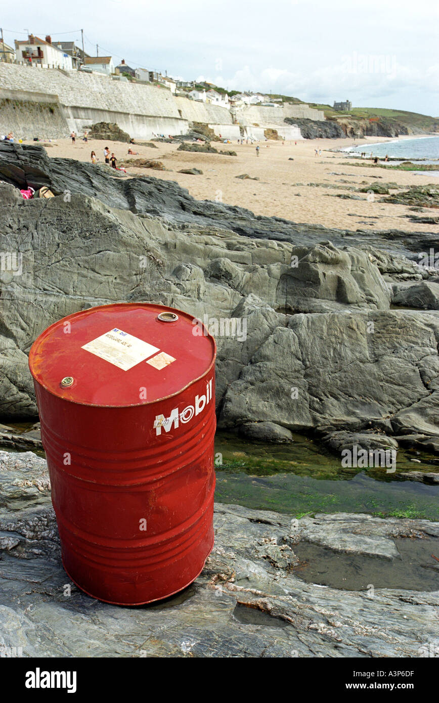 An oil drum washed up at Porthleven in Cornwall Britain UK - Stock Image