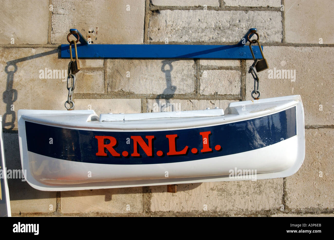 An RNLI collection pot shaped as a lifeboat - Stock Image