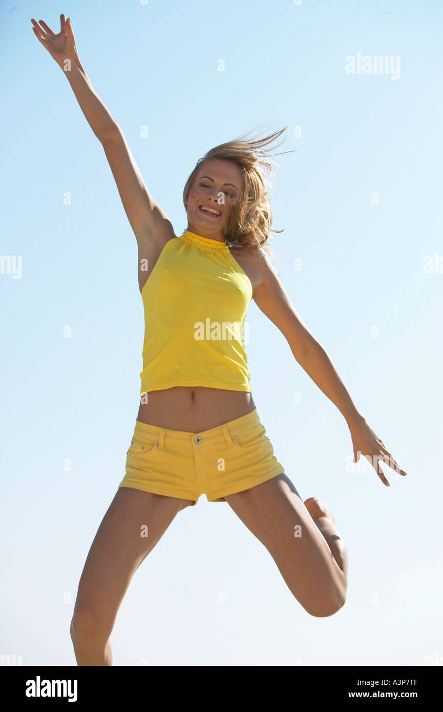 blonde woman at the beach - Stock Image