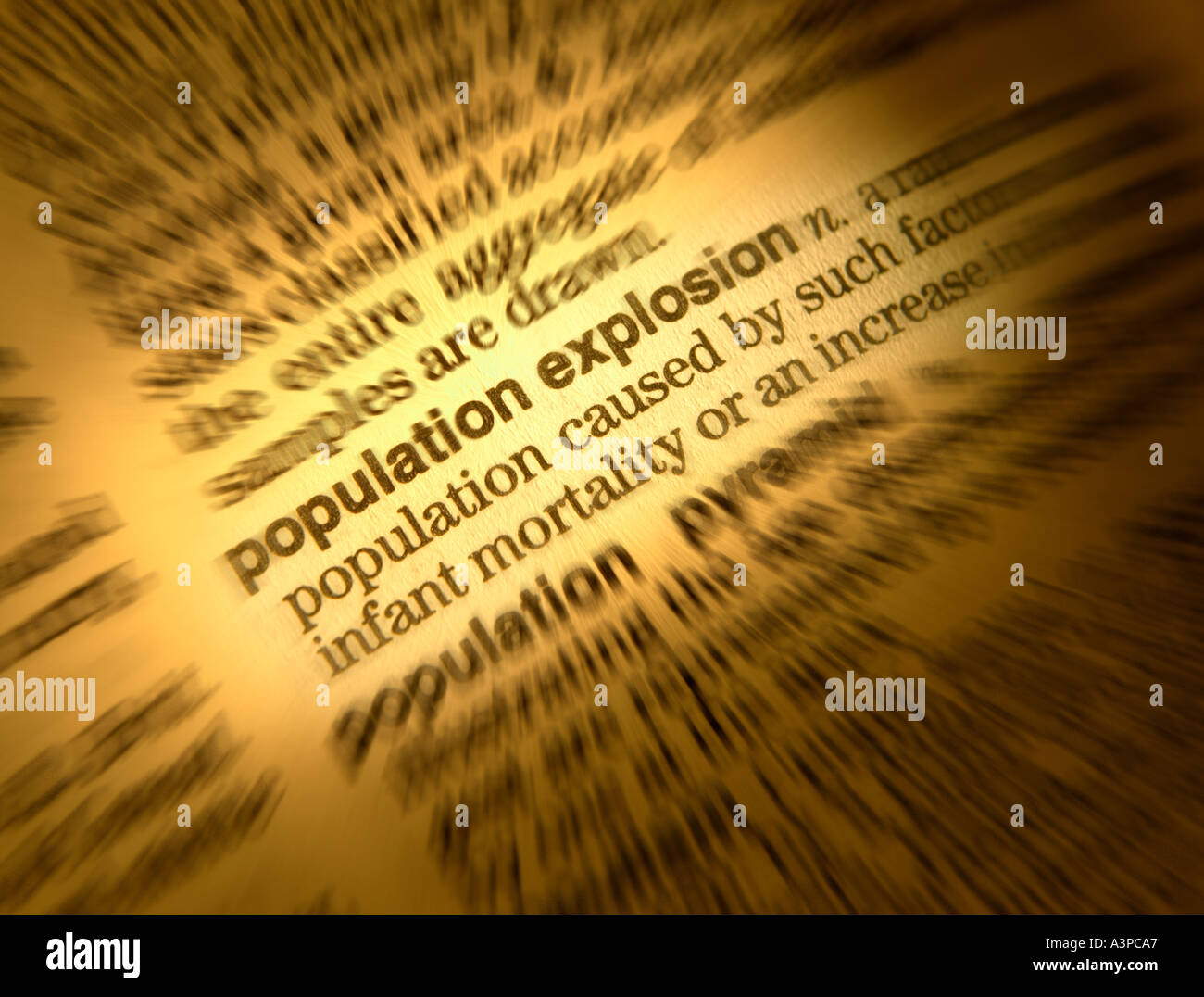 CLOSE UP OF DICTIONARY PAGE SHOWING DEFINITION OF THE WORDS POPULATION  EXPLOSION   Stock Image